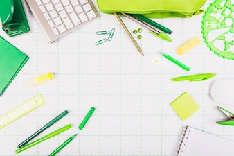 Office stationery scattered on table