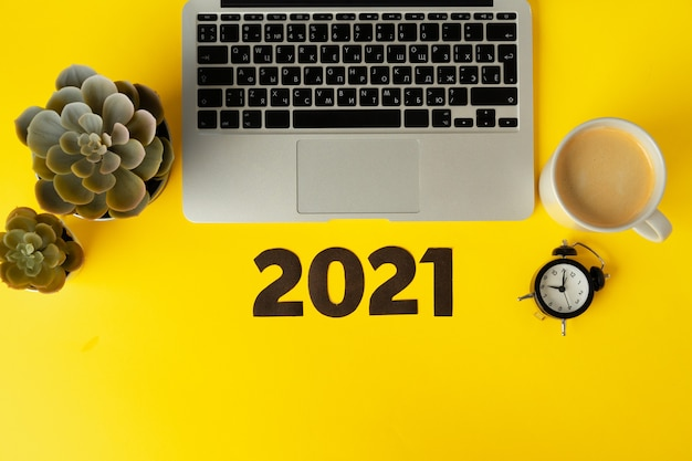 Office supplies and 2021 numbers. new year business goals and plans concept