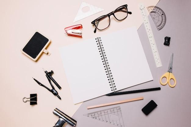 Office supplies around notebook