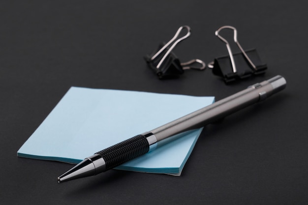 Office supplies on black background