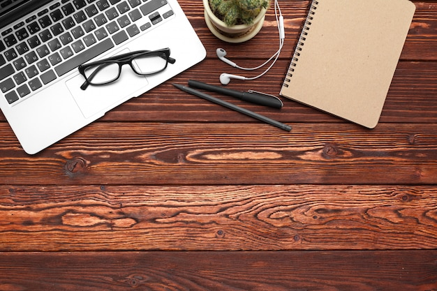 Office supplies and equipment on dark wooden table