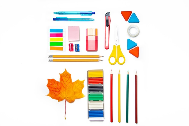 Office supplies layout on a white background copy space  school supplies colored stationery i