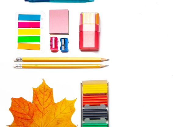 Office supplies layout on a white background copy space  school supplies colored stationery