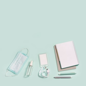Office supplies, notebooks, pens, mask for protection from infections and hand sanitizer
