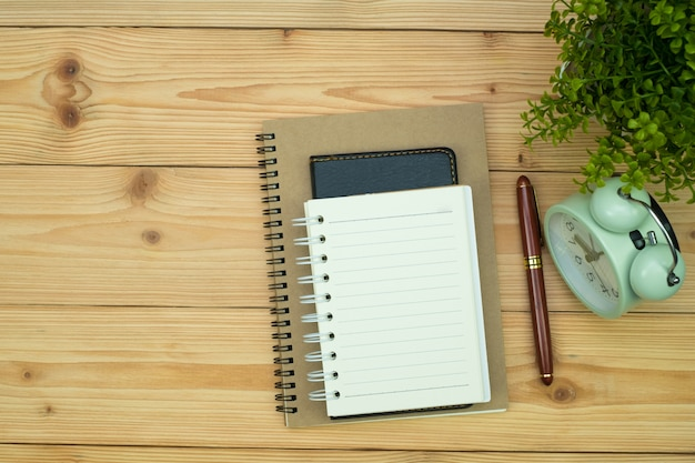 Office supplies or office work essential tools items on wood