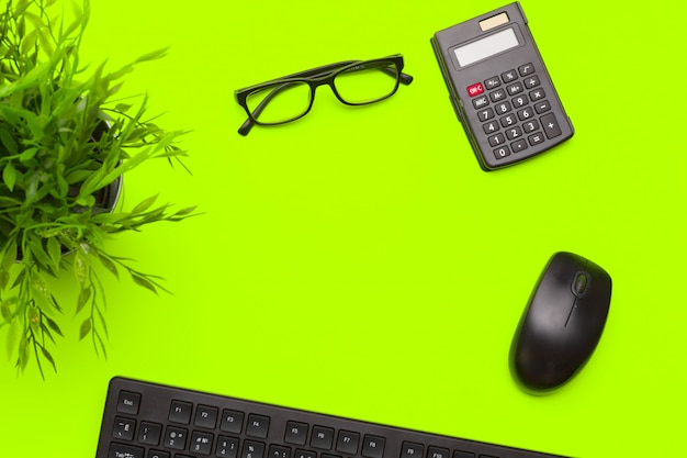 Office supplies and stationery on green background
