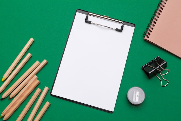 Office supplies and stationery on green