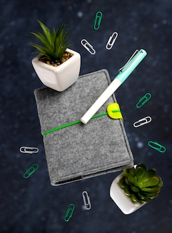 Office supplies stationery levitate over black background