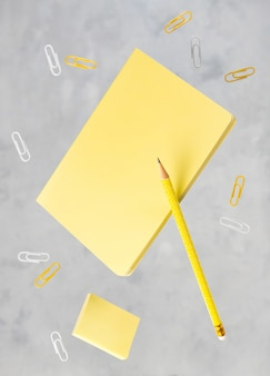 Office supplies stationery levitate over concrete gray background