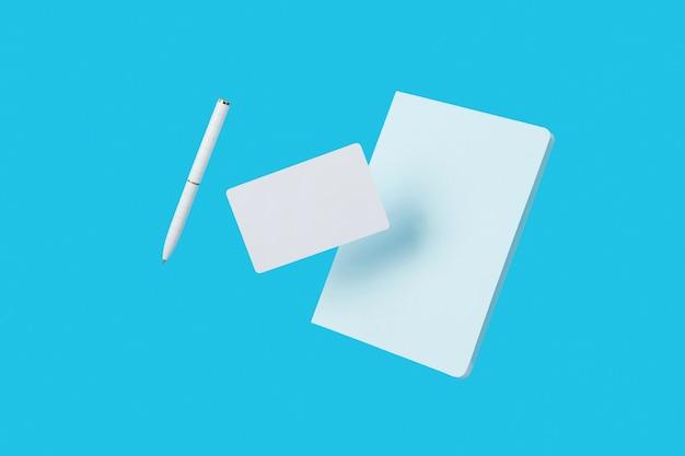 事務用品の文房具は、学校の創造的なレイアウトに戻って青い背景に浮揚します