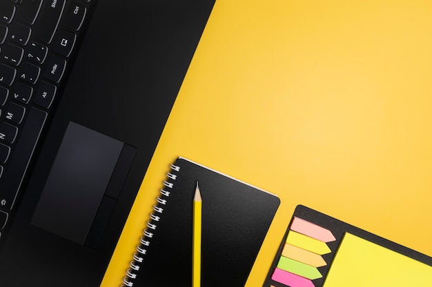 Office supplies on a yellow background.