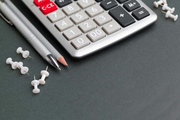 Office table calculator with pen