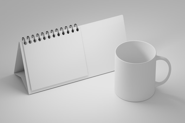 Office table template with white standing spiral calendar and blank coffee mug cup on white