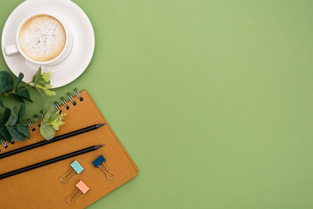 Office table with notebook and coffee cup. table top, work space with copy space. creative flat lay.