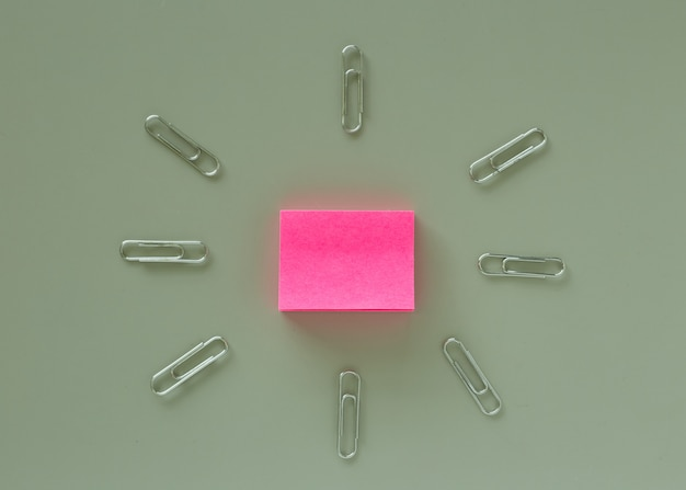 Office table with pink paper post it note