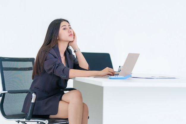 Office woman bored over her work on office desk