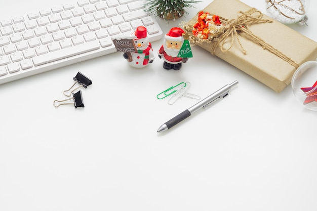 Office work space desktop with christmas decoration on white background