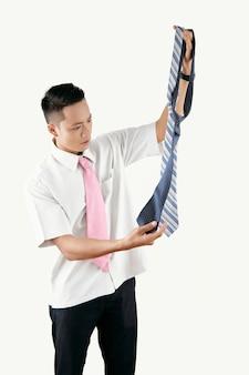 Office worker choosing tie