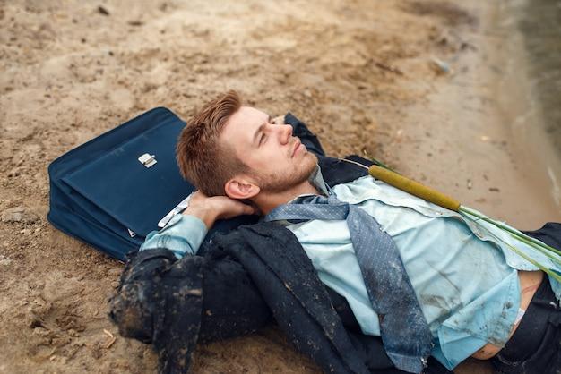 Office worker resting on the beach, desert island