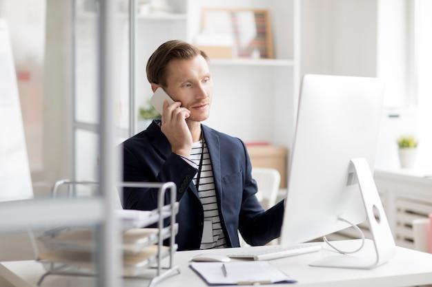 Office worker speaking by phone