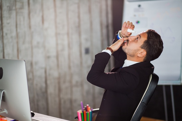 Office worker suffering dry eye syndrome