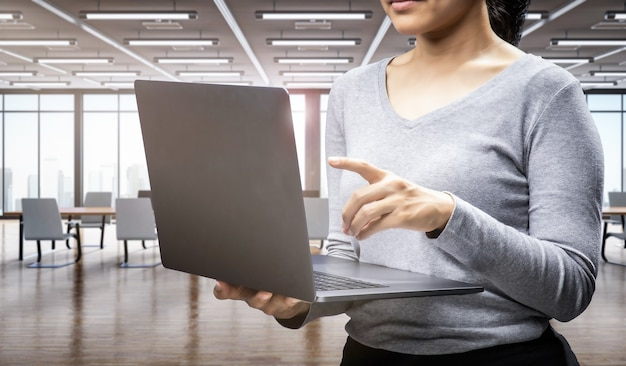 Office worker with computer notebook in office space or workspace