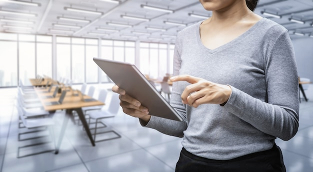 Office worker with digital tablet in office space or workspace Premium Photo