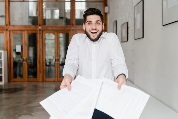 Office worker with papers in the office