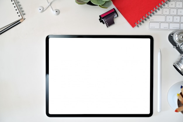 Office workspace desk with blank screen mockup tablet