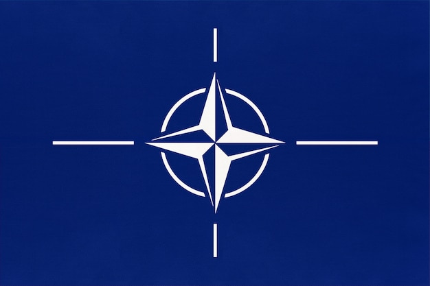 Official flag of the north atlantic treaty organization. nato sign and symbol of international alliance.