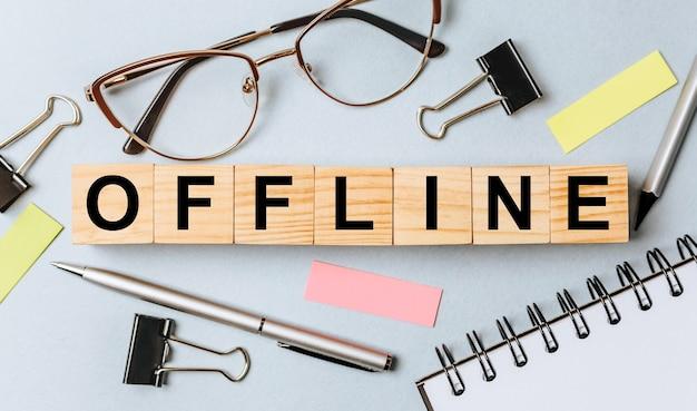 Offline word on wooden cubes on office desk