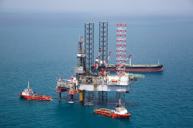 Offshore oil rig platform in the gulf from aerial view.