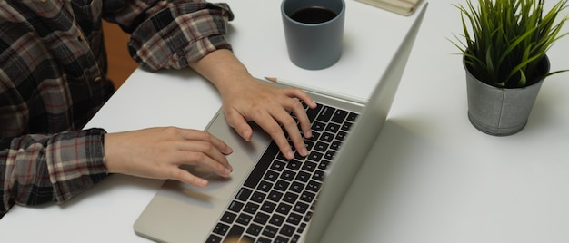 Ofice worker typing on computer keyboard