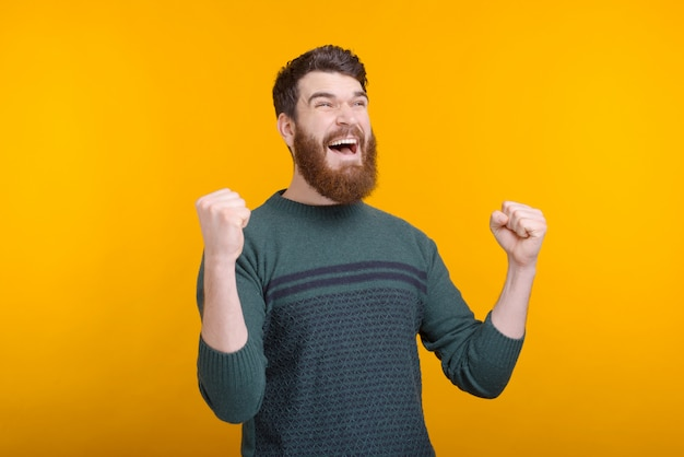 Oh yeah, i got it.  happy bearded guy is making the winner gesture on yellow space.