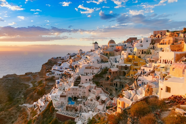 Oia or ia at sunset, santorini, greece