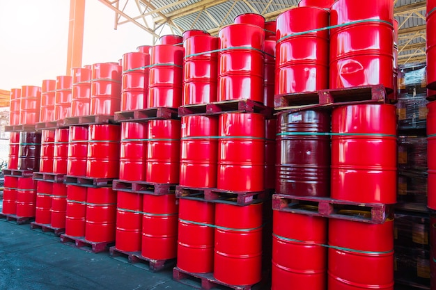 Oil barrels red or chemical drums vertical stacked up industry