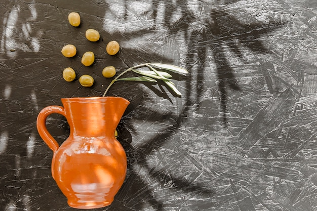 Oil decanter with olives on table