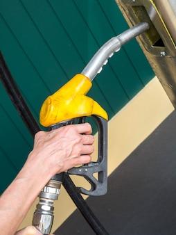 Oil dispenser in hand holding