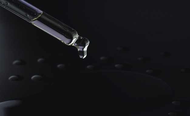 Oil dripping from a pipette on a black background