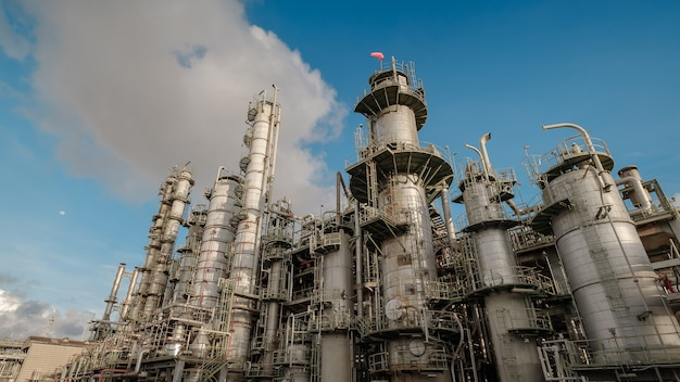 Oil and gas refinery industry on blue sky background, manufacturing of petroleum industrial plant