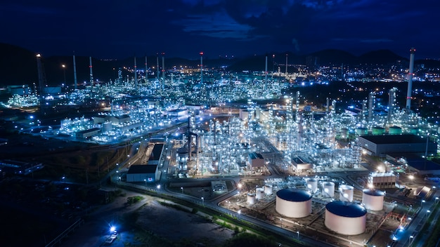 Oil and gas refinery industry and commercial storage at night aerial view