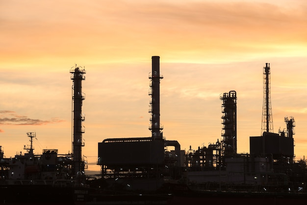 Oil and gas refinery industry factory at sunset