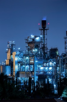 Oil and gas refinery industry plant with lighting, factory at night time