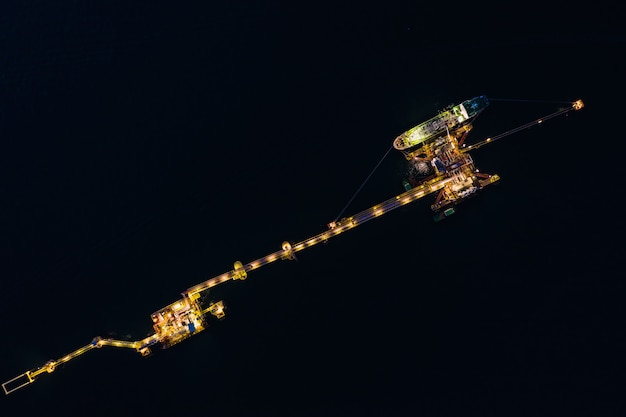 Oil and gas terminal on the sea with shipping loading oil business industry import and export