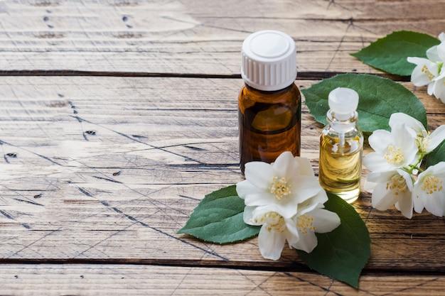 Oil of jasmine. aromatherapy with jasmine oil. jasmine flowers.
