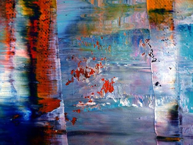 キャンバスのテクスチャの抽象的な背景に多色の油絵