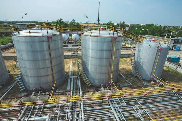 Oil pipeline and oil storage tank farm in the petroleum refinery.