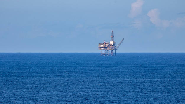 Oil platform in the midle of sea on a sunny day.