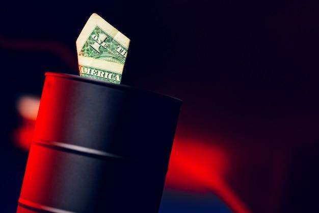 Oil prices fall concept. mini oil barrel against decline chart