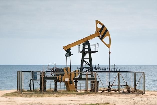 Oil pump jack at the caspian sea